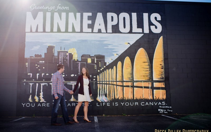 minneapolis engagement session with greetings from Minneapolis mural