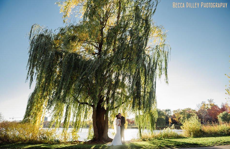 lake of the isles wedding photos with dramatic lighting minneapolis