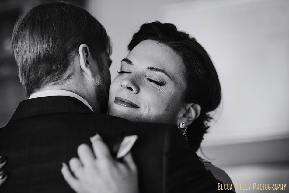 bride hugs groom for first look st paul college club winter wedding mn