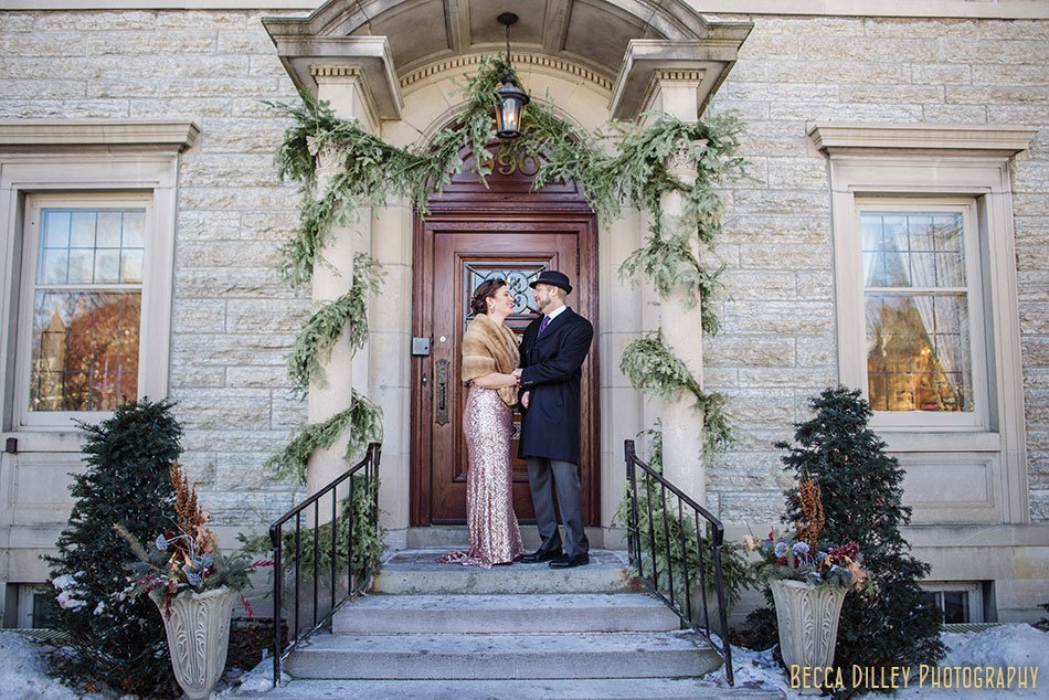 bride and groom in coats st paul college club winter wedding mn