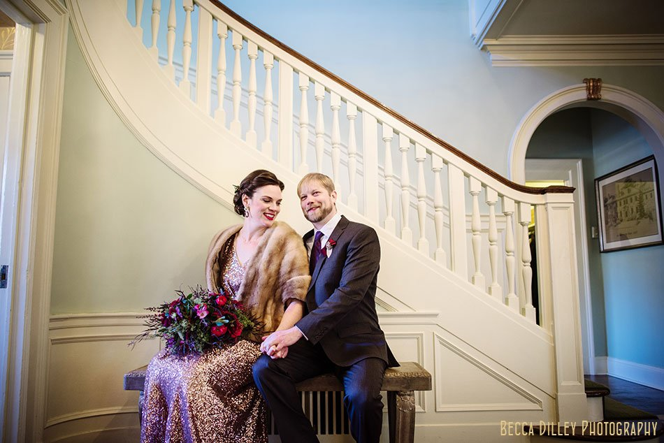 bride and groom on stairs st paul college club winter wedding mn