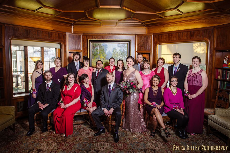 large wedding party posing st paul college club winter wedding mn