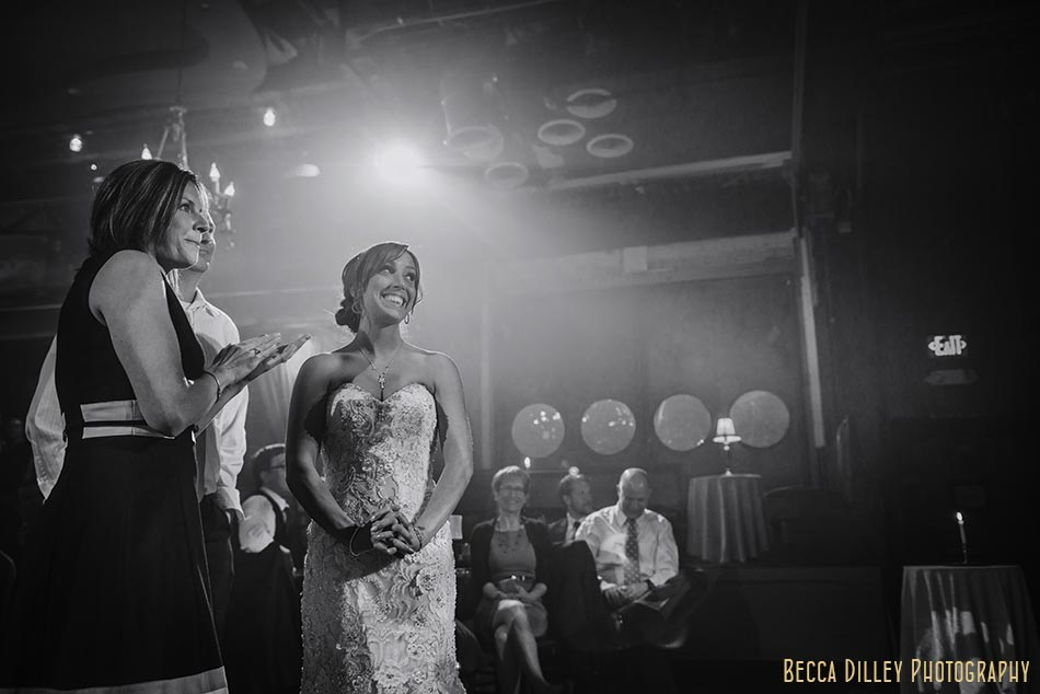 bride looks on during toasts minneapolis wedding photographer varsity theater april mn