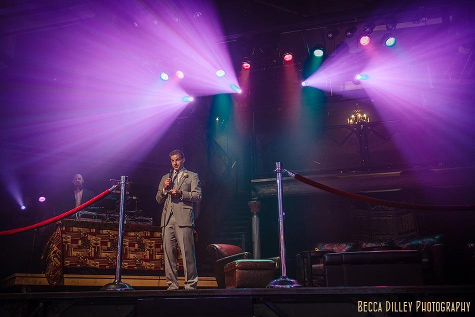 groom gives speech minneapolis wedding photographer varsity theater april mn