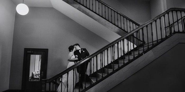 madison memorial union wedding bride and groom on stairs modern