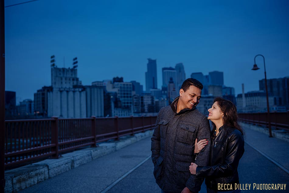 minneapolis engagement photos at stone arch bridge in winter