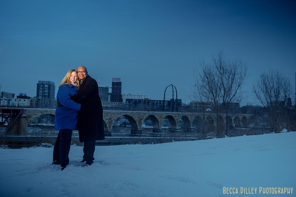 minneapolis winter engagement photos stone arch bridge