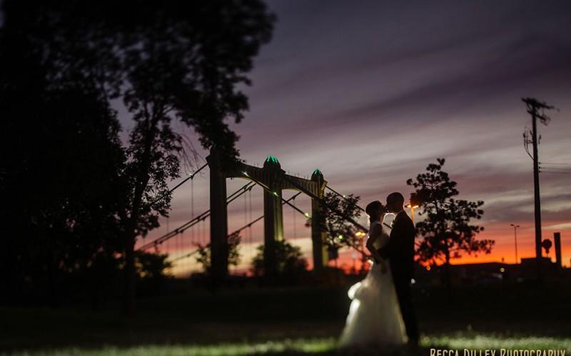 Bride and groom at night Nicollet Island Pavilion Wedding Minneapolis