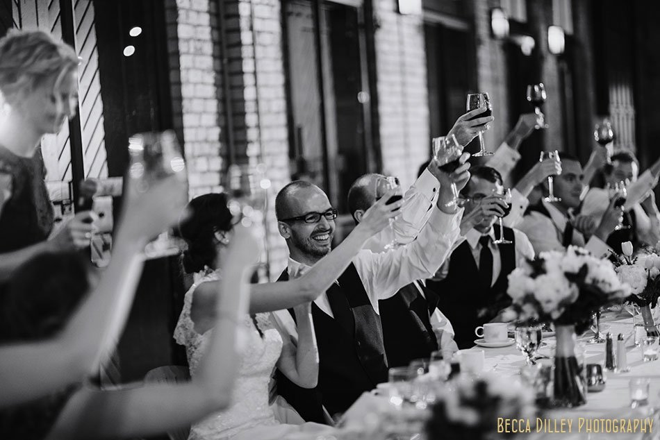 toasts Nicollet Island Pavilion Wedding Minneapolis