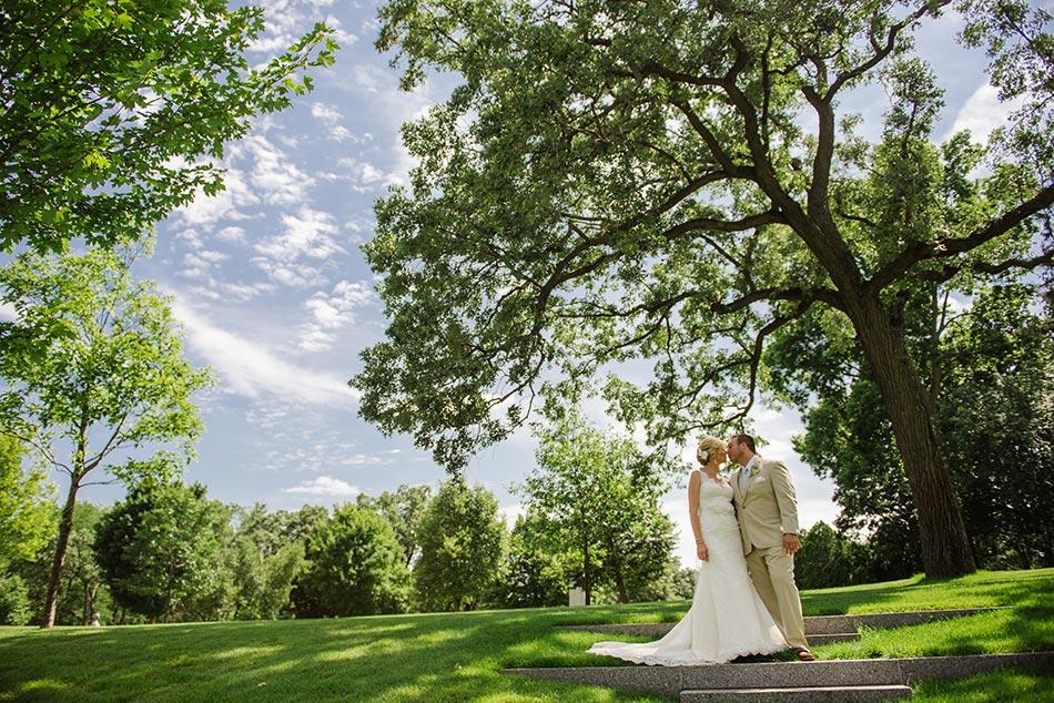 bride and groom on grounds lakewood chapel wedding minneapolis
