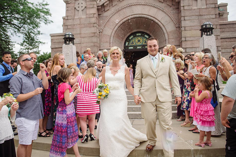 bride and groom exit church with bubbles lakewood chapel wedding minneapolis
