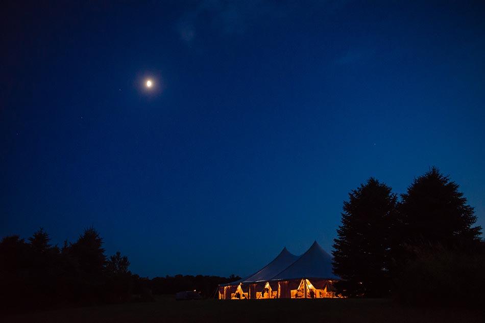tent at night minnesota wedding reception on family farm