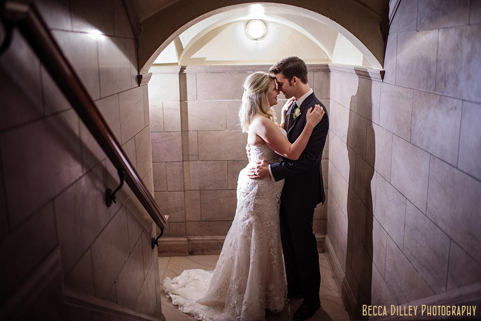 bride and groom in stairwell james j hill library wedding st paul mn photographer