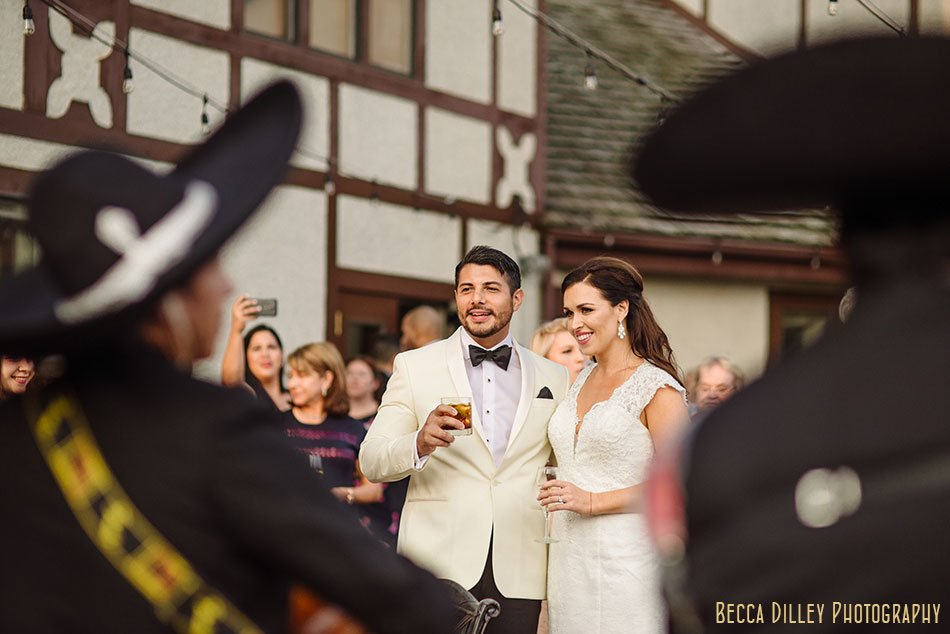 bride and groom listen to mariachi band wayzata country club wedding mn