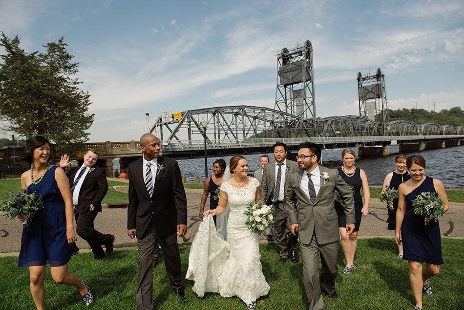 wedding party walking liftbridge Stillwater Historic Courthouse Wedding mn