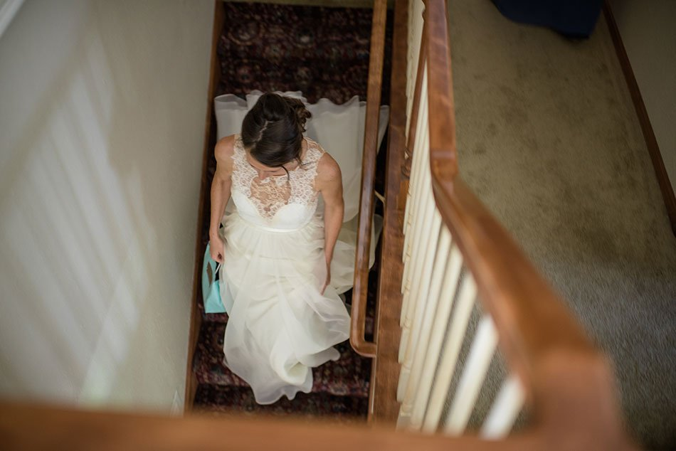 bride on stairs of childhood home White Bear Lake Backyard Wedding