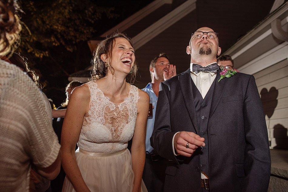 bride and groom laugh to live band White Bear Lake Backyard Wedding