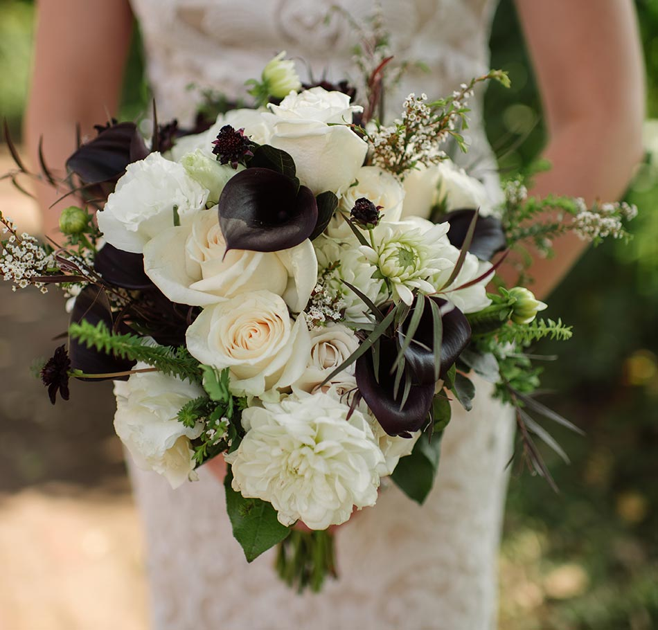white and black bouquet St Anthony Main wedding photos minneapolis