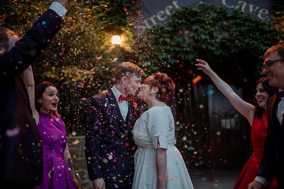 confetti on bride and groom at Wabasha Street Caves wedding st paul
