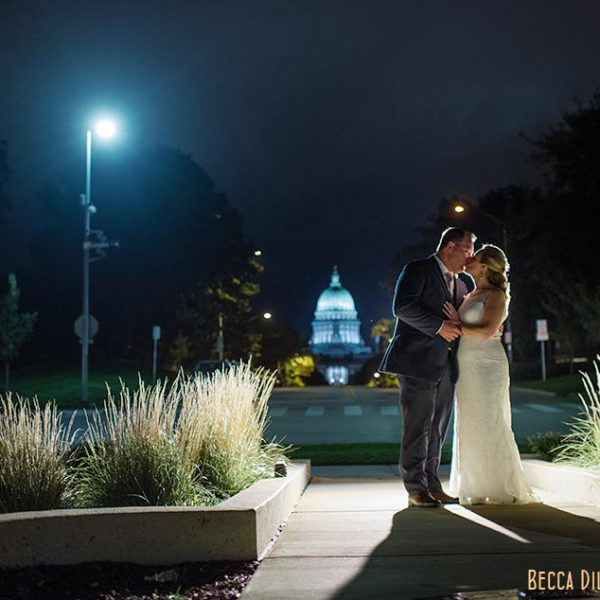 edgewater hotel wedding at night with capitol wisconsin