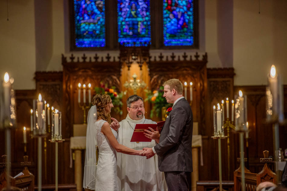 bride and groom exchange rings St Lukes Episcopal church wedding minneapolis