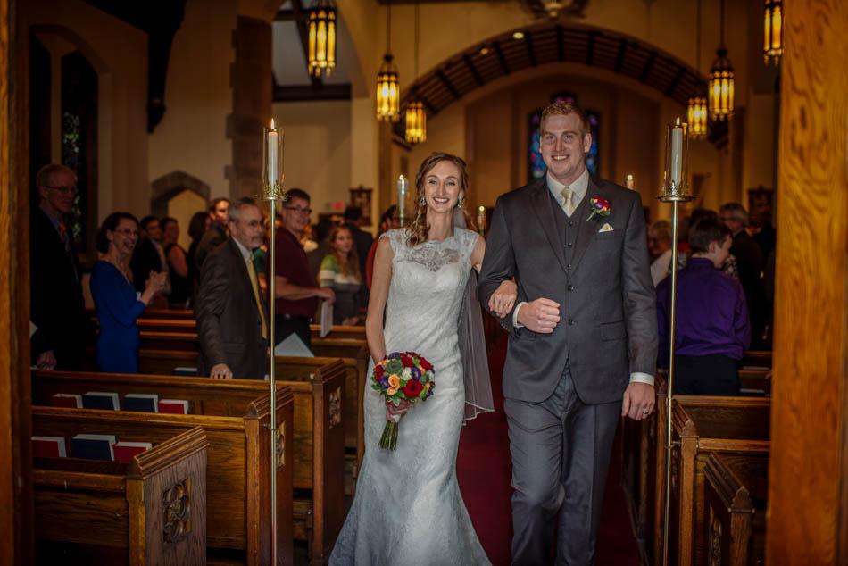 bride and groom walk down aisle St Lukes Episcopal church wedding minneapolis