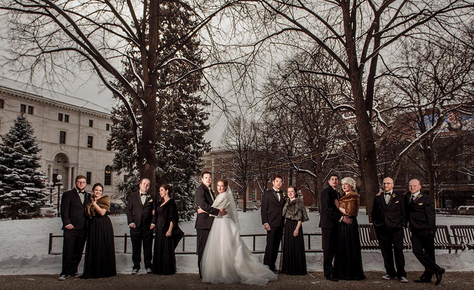 flash composite of wedding party St Paul Hotel winter wedding mn