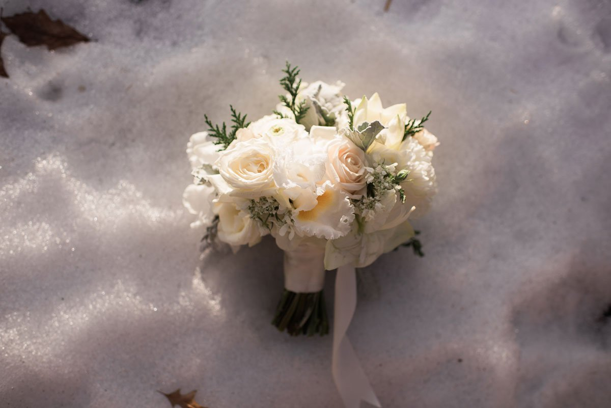 winter bouquet in snow fun minneapolis wedding at greek orthodox church and varsity theater
