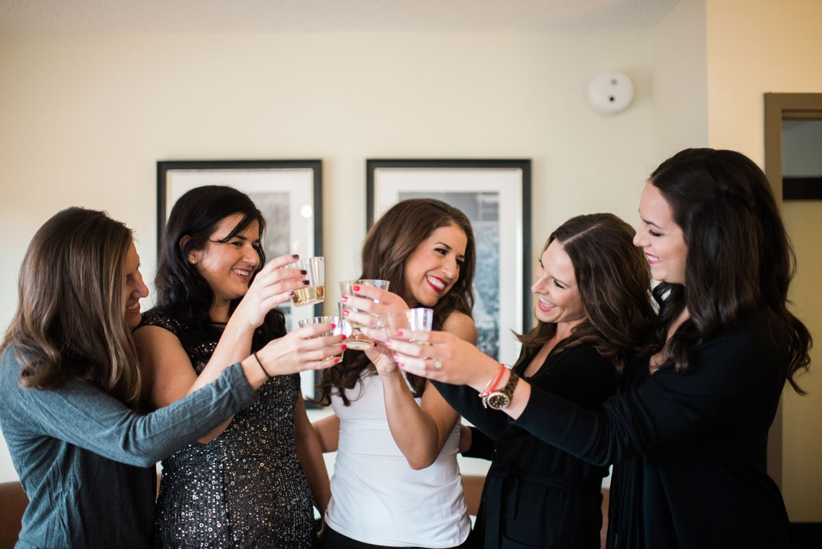 bride and friend drinking champagne