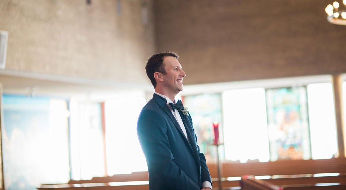 groom waits for bride fun minneapolis wedding st marys greek orthodox church