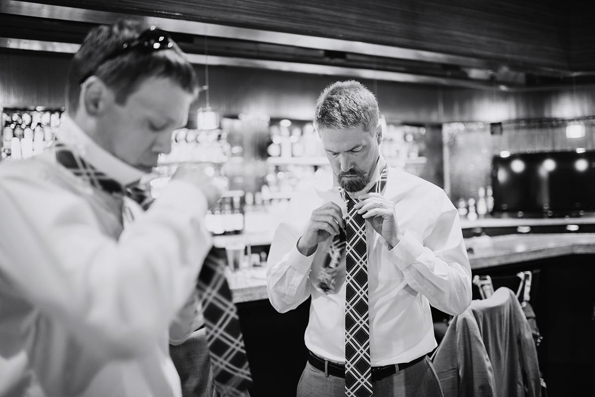 guys getting ready in bar Outdoor Minneapolis Wedding