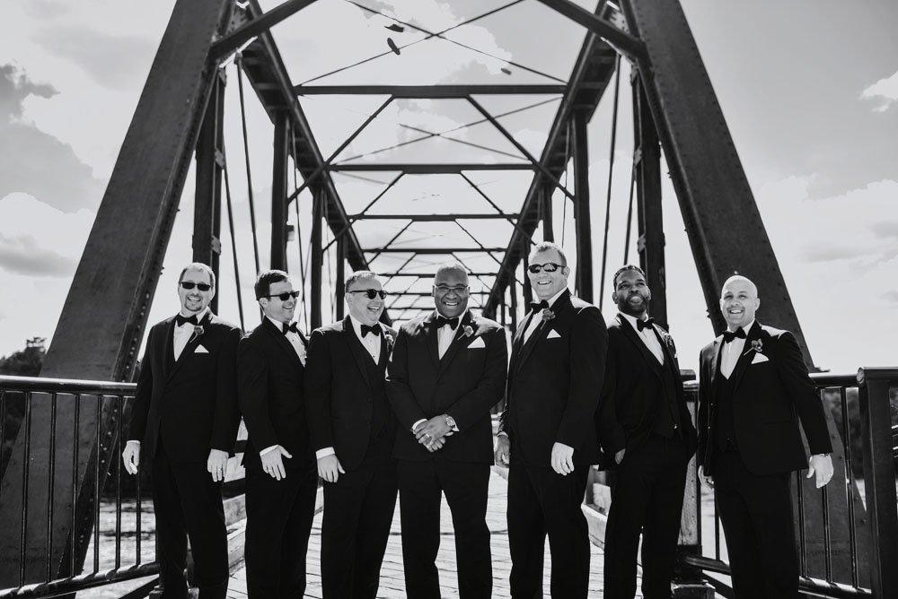 groomsmen on bridge eau claire wi wedding
