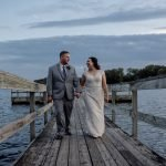 Wedding couple on dock at Bryant Lake Pavilion, MN