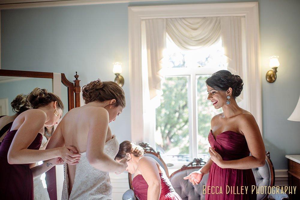 bride getting dressed Minneapolis Gale Mansion Wedding