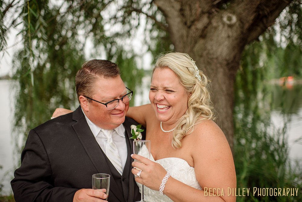 couple with champagne toast Majestic Oaks Golf Club Wedding MN