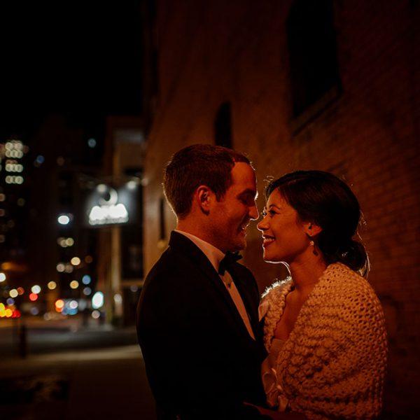Night portrait outside Aria Minneapolis warehouse wedding