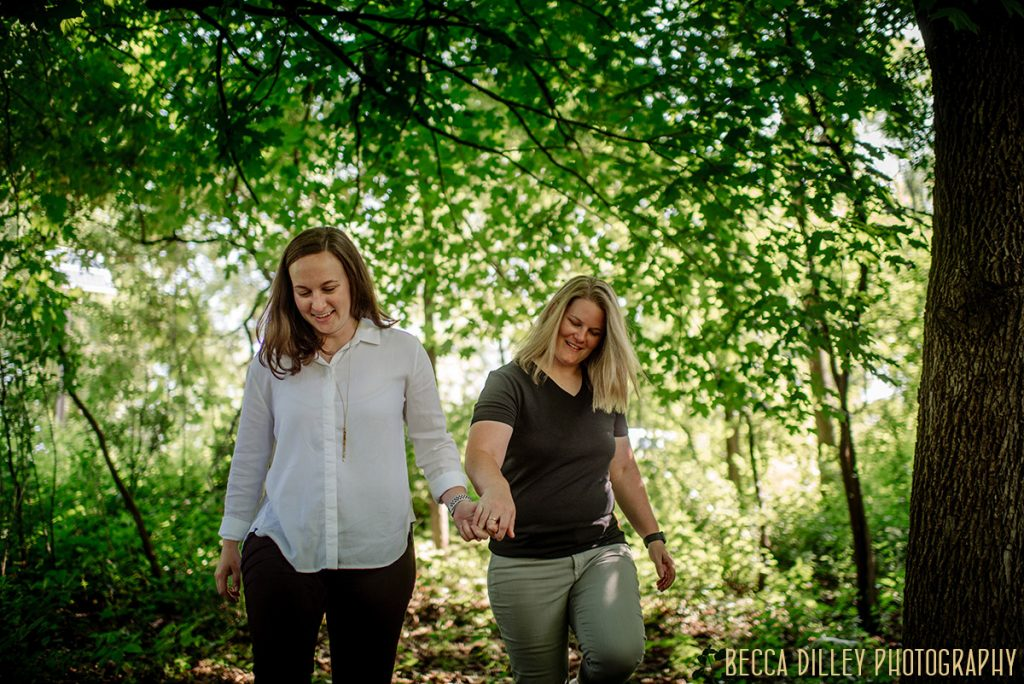 Richardson Nature Center engagement photos walking through the woods