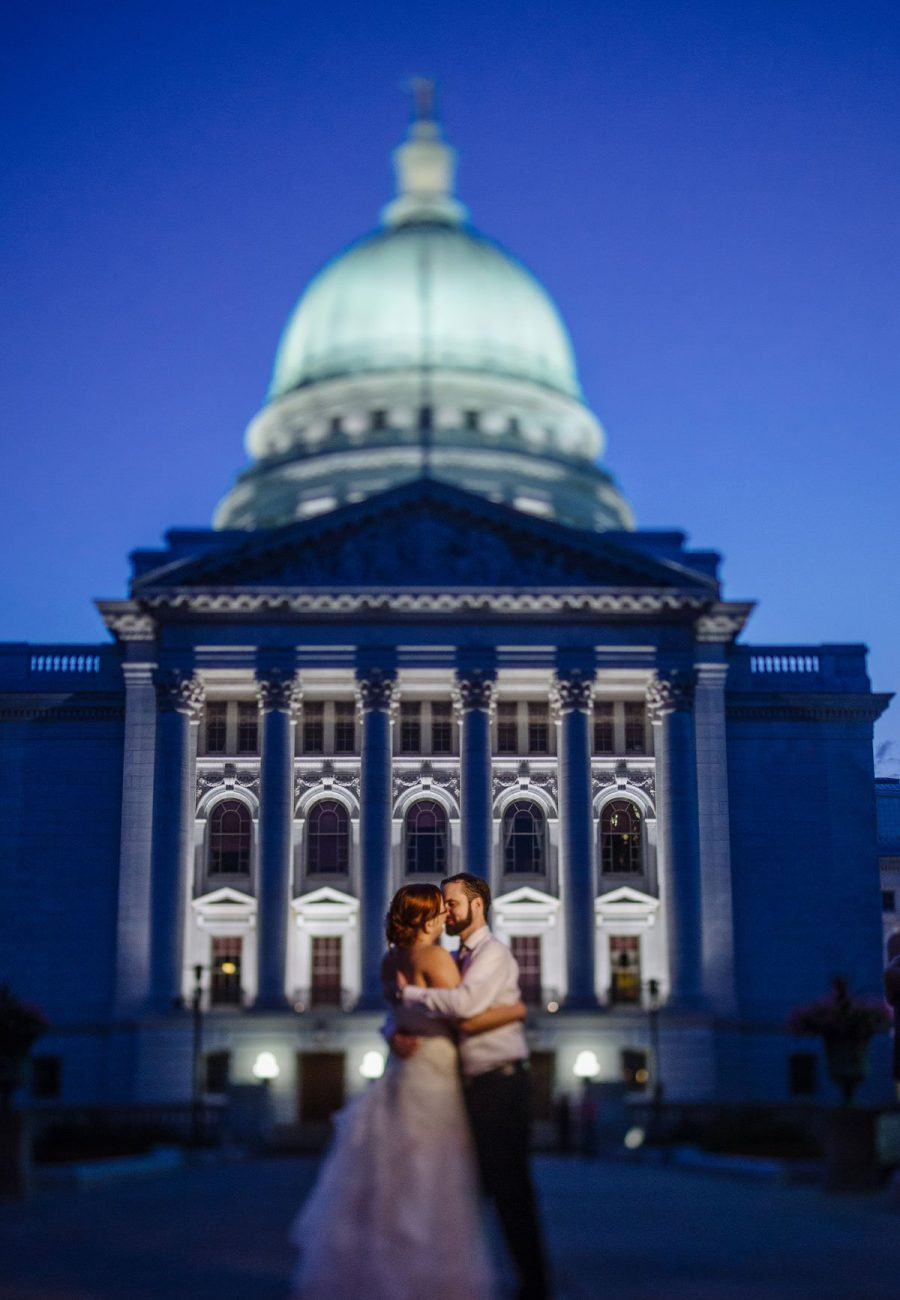 couple kiss outside of Madison Capitol building
