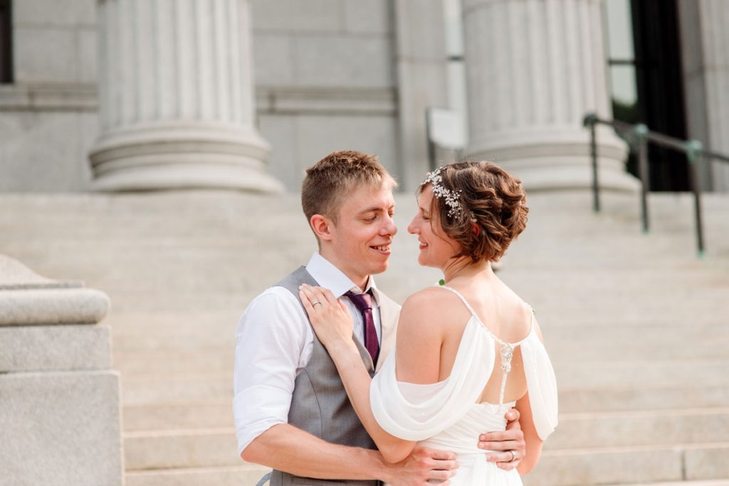 couple embrace on stairs of Minneapolis Institute of Art