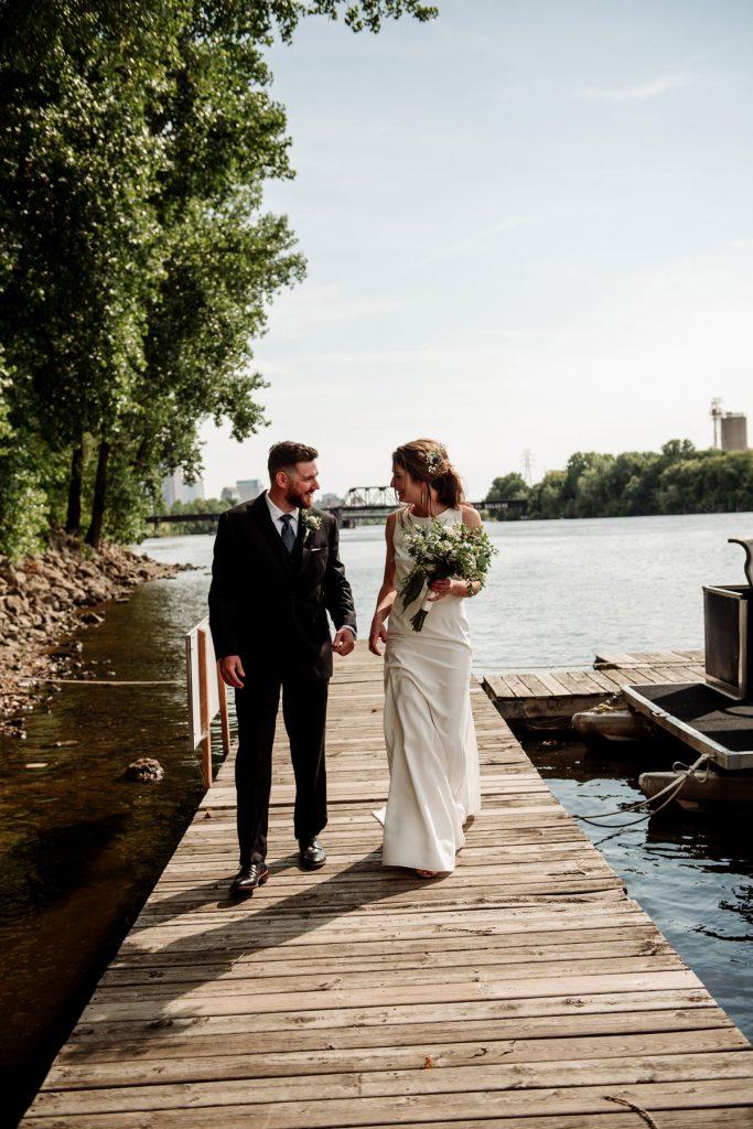 couple on docks in northeast minneapolis before dive bar wedding
